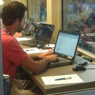 Working hard in the press box at Coca-Cola Park