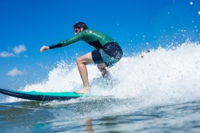 Learning to surf while on assignment in Bali
